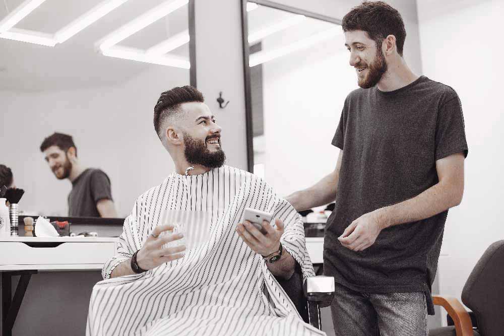 stylish-man-sitting-in-a-barbershop-CKF2KVB.jpg
