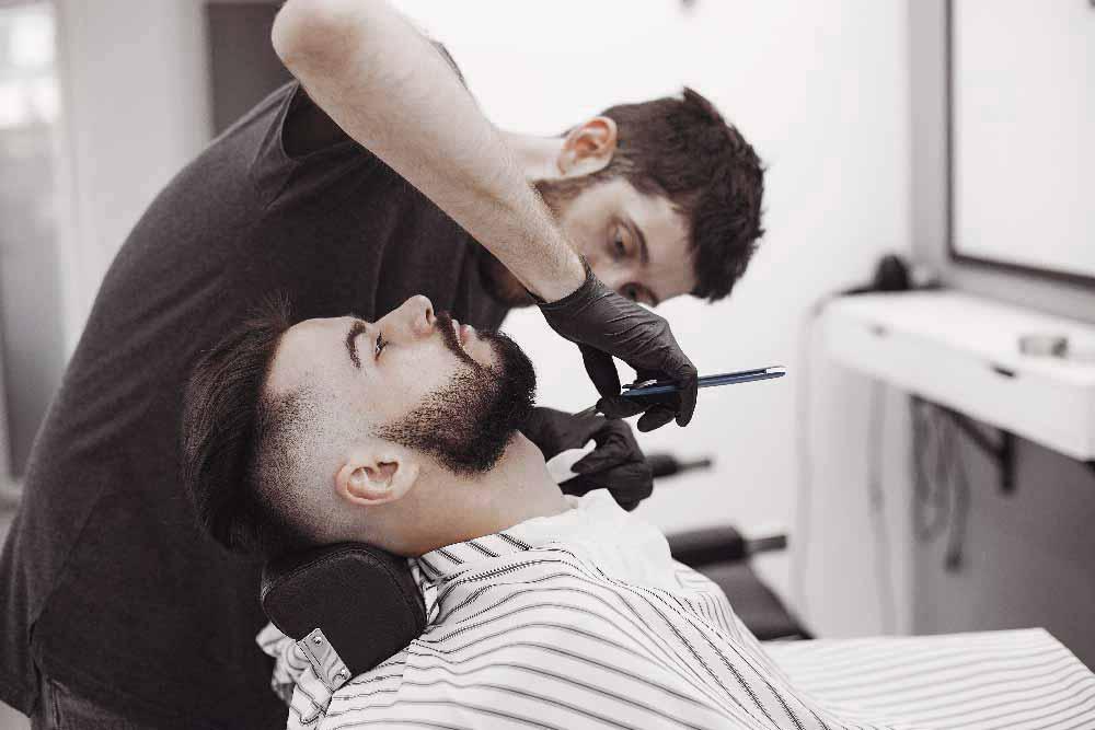 stylish-man-sitting-in-a-barbershop-U4YAVRL.jpg